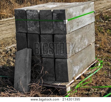 The pallet with a borders on a building site. Concrete curbs
