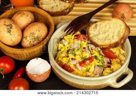 Scrambled eggs with herbs simple full protein breakfast with fresh herbs. Bio eggs from domestic breeding. Healthy food