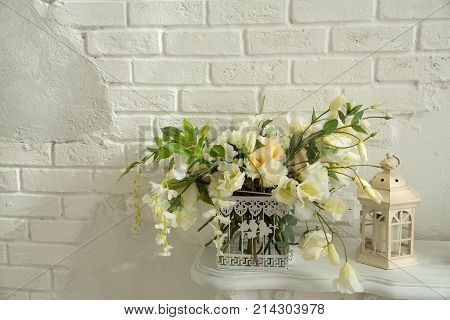 beautiful bouquet of white flowers with a décor on the background of a light wall