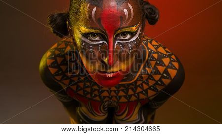 Bodypainting. Portrait of a woman painted in ethnic patterns