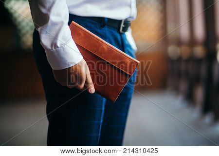 The business man with a purse in hands. Close up.
