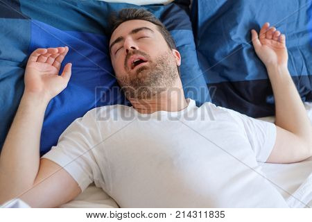 Face Close Up Of Snoring Man Because Of Hypopnea Disorder
