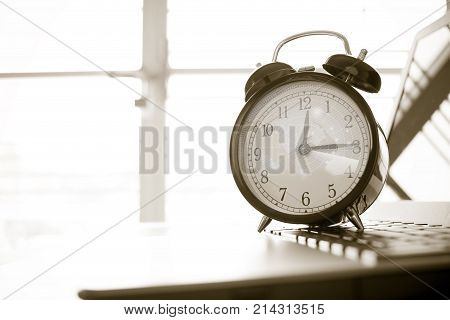 Alarm clock with Radar background on computer businessman using smart phone background. Concept of Times Studies lead to success in life black and white color.