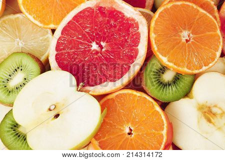 Fruit textures. Kiwi orange grapefruit lemon apple pear pomegranate mandarin fruits as background cover wallpaper. Colorful fresh fruits in rainbow colors. Beautiful delicious fruits wallpaper. Colorful.