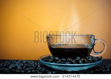 Cup of coffee with fume on a brown background - closeup