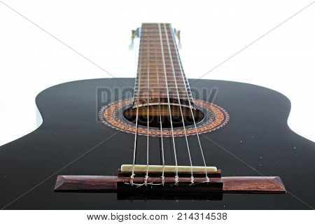 Guitar artsy POV background. Music illustration. Black and white guitar closeup. Black classical guitar.