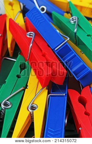 clothespin clothespins as background. Colorful forecaps tweezers clips as background. Rainbow colors. Forecap tweezer texture closeup. Photo.