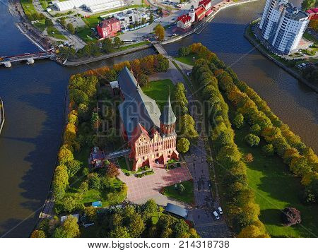 Aerial cityscape of Kaliningrad Russia. Gothic cathedral in Kaliningrad city formerly Koenigsberg Germany. Beautiful view of Kant Island. The center of city in autumn. Birds eye panorama