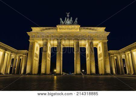Brandenburg gate at night Berlin Germany Europe. Beautiful german architecture. Brandenburger Tor with night illumination. Popular landmark in centre of Berlin. Famous travel destination of Germany