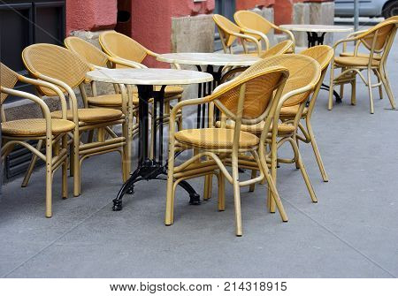 tables and chairs in a restaurant on the street