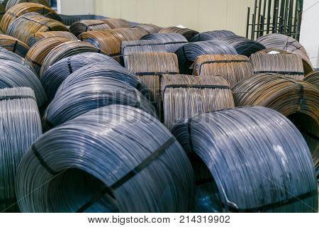 Rolls of aluminum metal fittings steel armature . Heavy industry production. Metal rolling plant