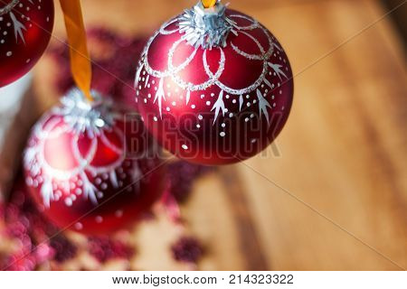 Christmas Ball Ornaments Decoration Hanging On Fir Tree Branch Over Red Lights Background .