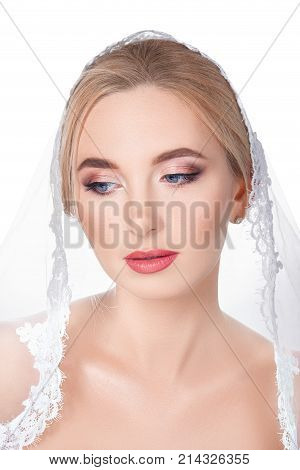 Beautiful bride with veil isolated on white background. Wedding makeup. Concept of beauty, fashion, wedding
