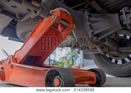 Change Wheel On A Car That Lifting The Car Up To Change It In Garage That Take Out The Nut Form Trie