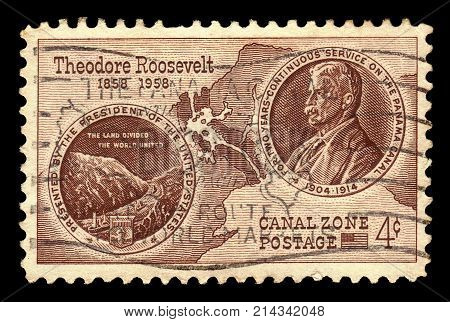 Territories of the United States, Canal Zone (Panama) - CIRCA 1958: A stamp printed in the United States shows view of the Panama Canal and portrait Theodore Roosevelt, circa 1958