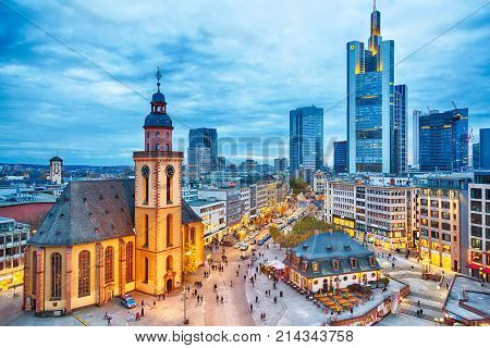 FRANKFURT GERMANY - NOVEMBER 2017: View to skyline of Frankfurt in sunset blue hour. St Paul's Church and the Hauptwache Main Guard building at Frankfurt central street Zeil