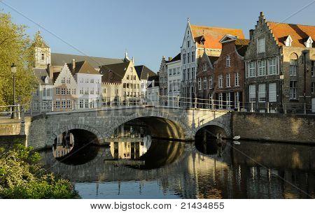 A old brick bridge over a river in Brugge in Belgium