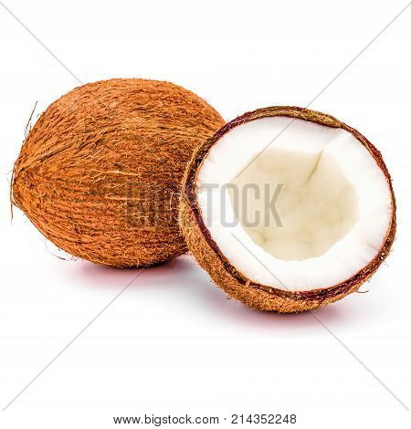 close up of whole and broken coconuts isolated on white background. coco fruit