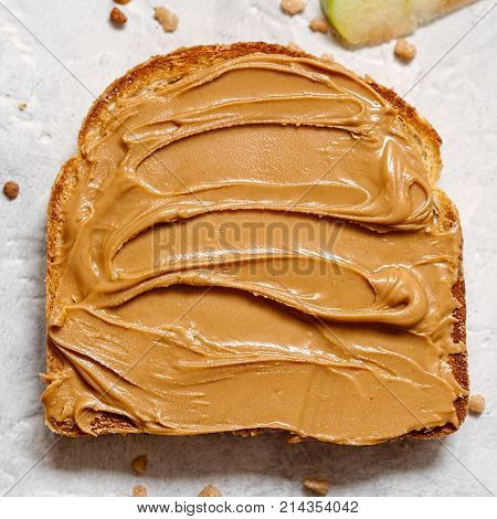 peanut butter spread on a slice of Toast
