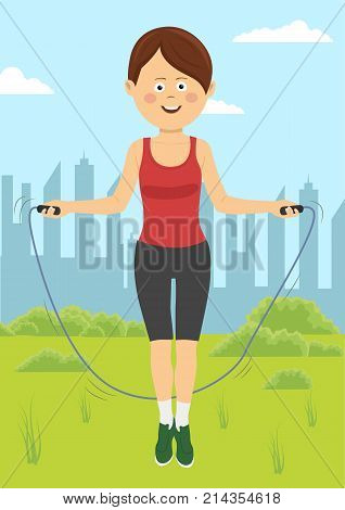 Fit young woman jumps with rope in a park. Fitness female doing skipping workout outdoors on a sunny day.