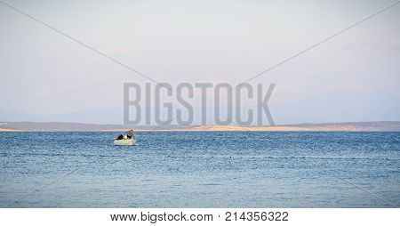 A Fisher In A Little Boat