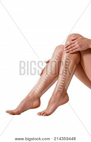Beautiful slim fit woman touching her body with arrows isolated on white background. Fat lose, liposuction and cellulite removal concept. Plastic surgery