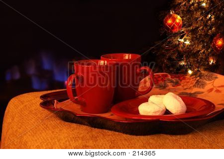 Hot Drinks And Powdered Sugar Donuts By The Fire