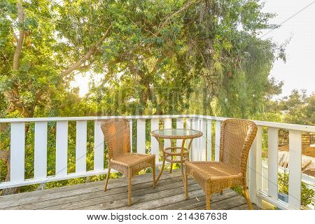 Golden Light Creates A Scene On This Upper Deck With Sitting Area And Small Table Ready For A Coffee