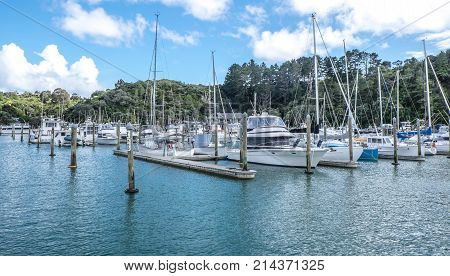 Yachts sail bots and motor launches moored at Tutukaka Marina in Northland North Island New Zealand NZ - copy space in water area