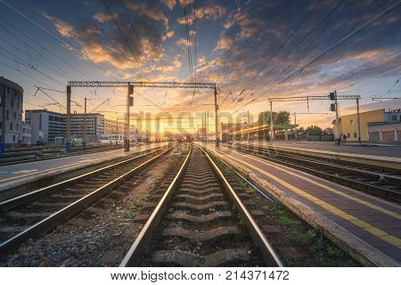 Railway Station Against Beautiful Colorful Sky At Sunset.