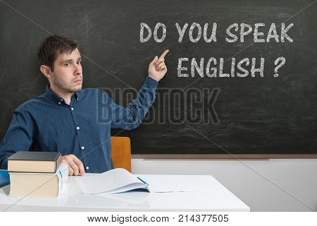 Young teacher is teaching English language at school.