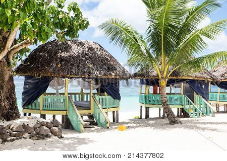 Lalomanu Beach Upolu Island Samoa - October 27 2017: Colorful open-sided Samoan beach fale huts are an alternative to hotel or resort accommodation