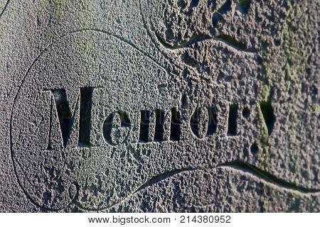Fading memory. Inscription on ancestral grave headstone. Distant memory fading. Forgetfulness and age-related mental health problem represented by selective focus on ancient memory.