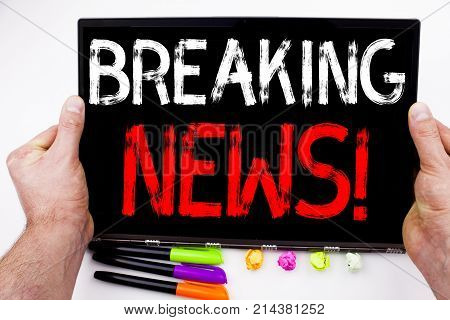 Breaking News Text Written On Tablet, Computer In The Office With Marker, Pen, Stationery. Business