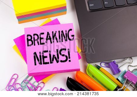 Writing Text Showing Breaking News Made In The Office With Surroundings Such As Laptop, Marker, Pen.