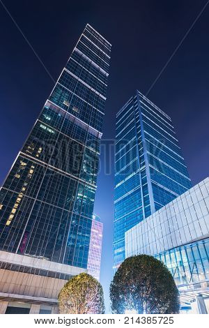Chengdu, China - Jan 14, 2016 : IFS skyscrapers low angle view at night in the center of Chengdu city