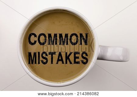 Word, Writing Common Mistakes Text In Coffee In Cup. Business Concept For Common Decision Mistakes O
