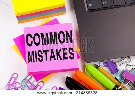 Writing Showing Common Mistakes Made In The Office With Surroundings Such As Laptop, Marker, Pen. Bu