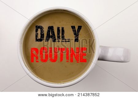 Word writing Daily Routine text in coffee in cup. Business concept for Accuracy Procedure on white background with space. Black text with red word. poster