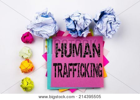 Writing Text Showing Human Trafficking Written On Sticky Note In Office With Screw Paper Balls. Busi