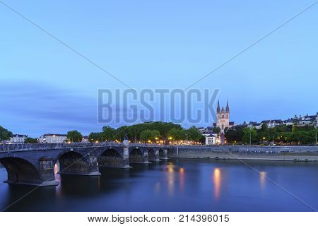 Pont de Verdun or Verdun bridge across the Maine river and Cathedral St. Maurice in Angers France