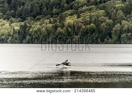 Canada Ontario Lake of two rivers Couple on a Canoe Canoes on the water in Algonquin National Park