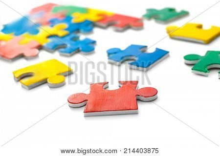Colorful puzzle on white background. Autism awareness concept