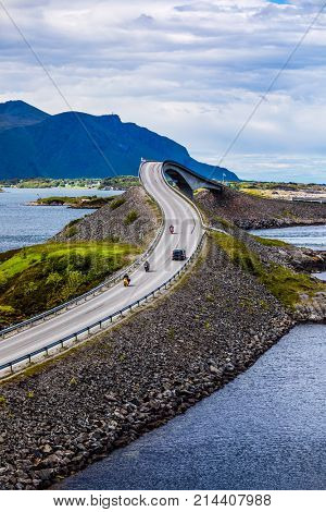 Three bikers on motorcycles. Atlantic Ocean Road or the Atlantic Road (Atlanterhavsveien) been awarded the title as