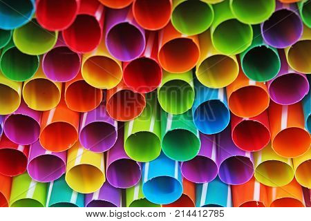 Fancy straw art background. Abstract wallpaper of colored fancy straws. Rainbow colored colorful pattern texture. Art artsy colorful rainbow cover photo.