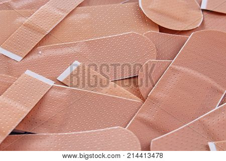 Adhesive plaster background. Medical photo texture pattern cover. Adhesive plasters studio photo. Medical.