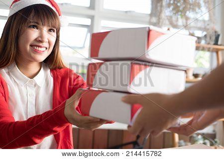 Startup Small Business Owner Give Parcel Box To Delivery Man For Sending To Customer. Woman's Hand R