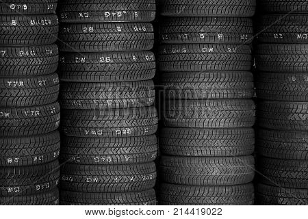 Tires for sale at a tire store - stacks of new tires