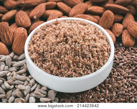 Homemade LSA mix in plate - Linseed or flax seeds, Sunflower seeds and Almonds. Traditional Australian blend of ground, source of dietary fiber, protein, omega fatty acids. Copy space for text.