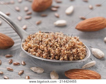 Homemade LSA mix in spoon - Linseed or flax seeds, Sunflower seeds and Almonds. Traditional Australian blend of ground, source of dietary fiber, protein, omega fatty acids. Copy space for text.